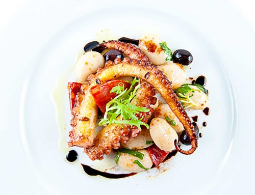 Grilled Sous-Vide Octopus w/ Corona Beans, Chorizo & Sherry-Smoked Paprika Vinaigrette